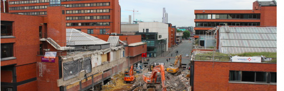 The demolition of a bridge at Manchester Business School